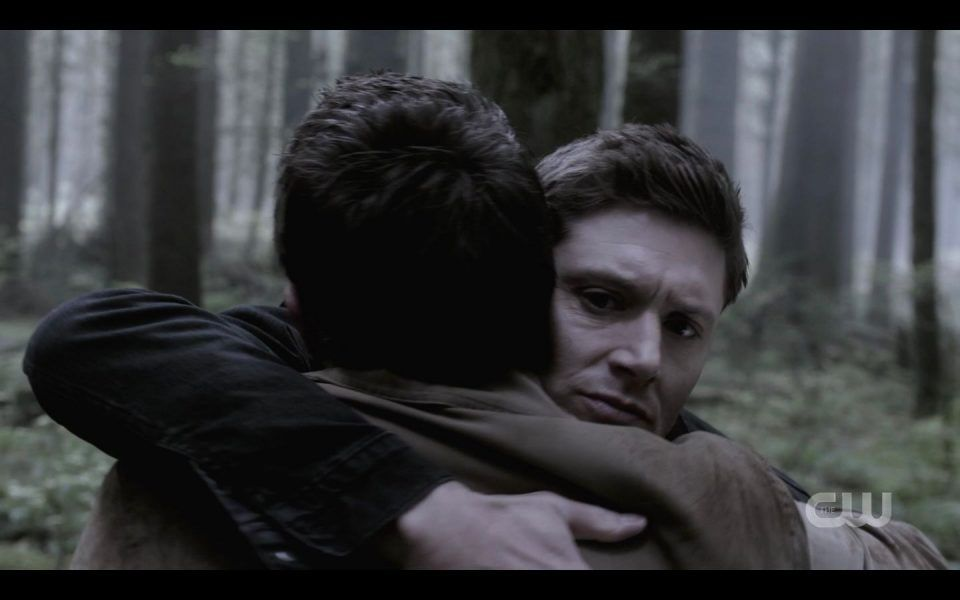 Dean Winchester huggin Castiel tight in woods SPN