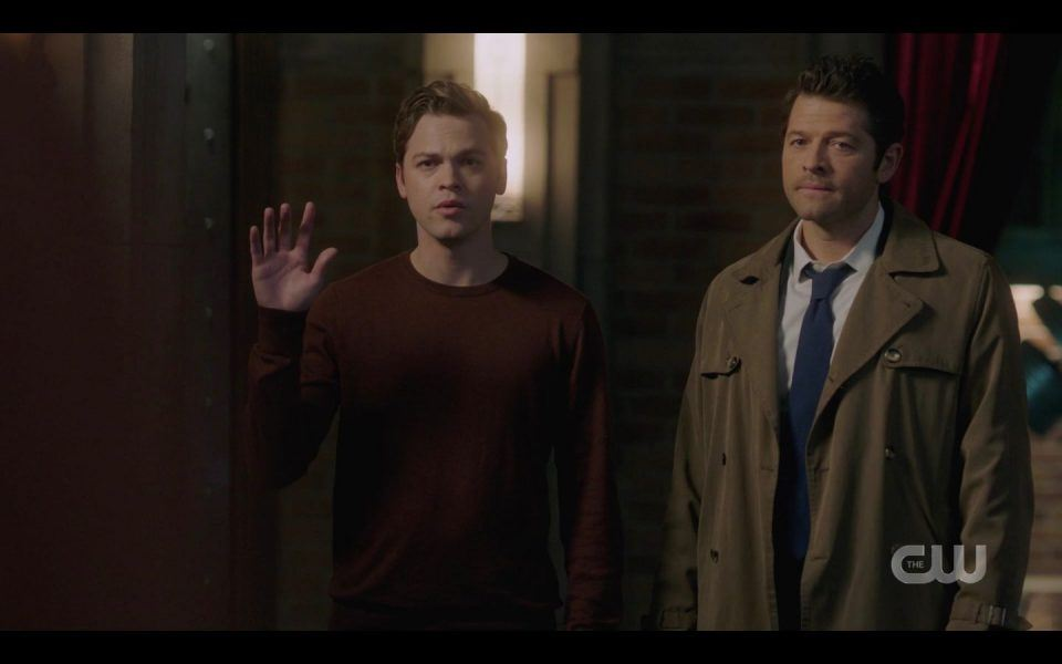 Jack with Castiel giving signature wave to Winchester brothers