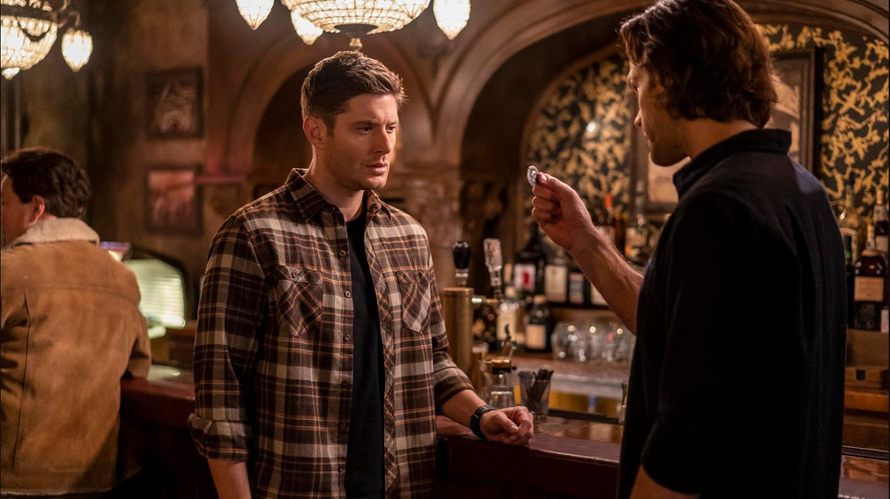 Supernatural 1511 The gamblers sam winchester holding out ancient coin to dean