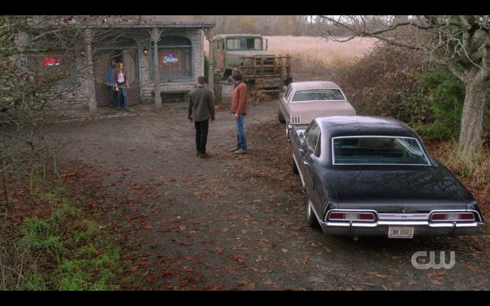 Winchester Brothers outside of pool hall with Impala Baby