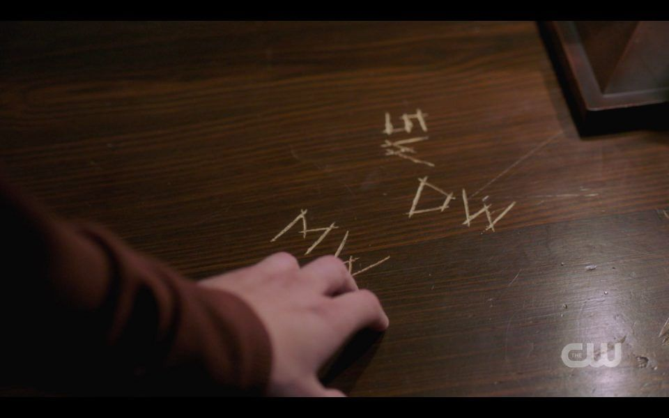 Jack touching Mary Winchester initials scratched into table SPN 1512