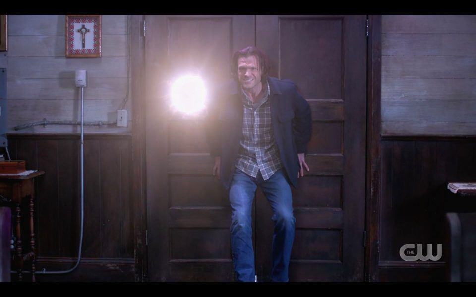 Sam Winchester running into church with hellhounds and Jack