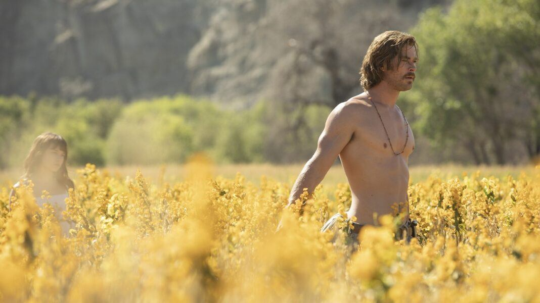 chris hemsworth shirtless walk through flowers camino royale movie