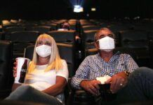 moviegoers wearing maskes at tenet screening 2020