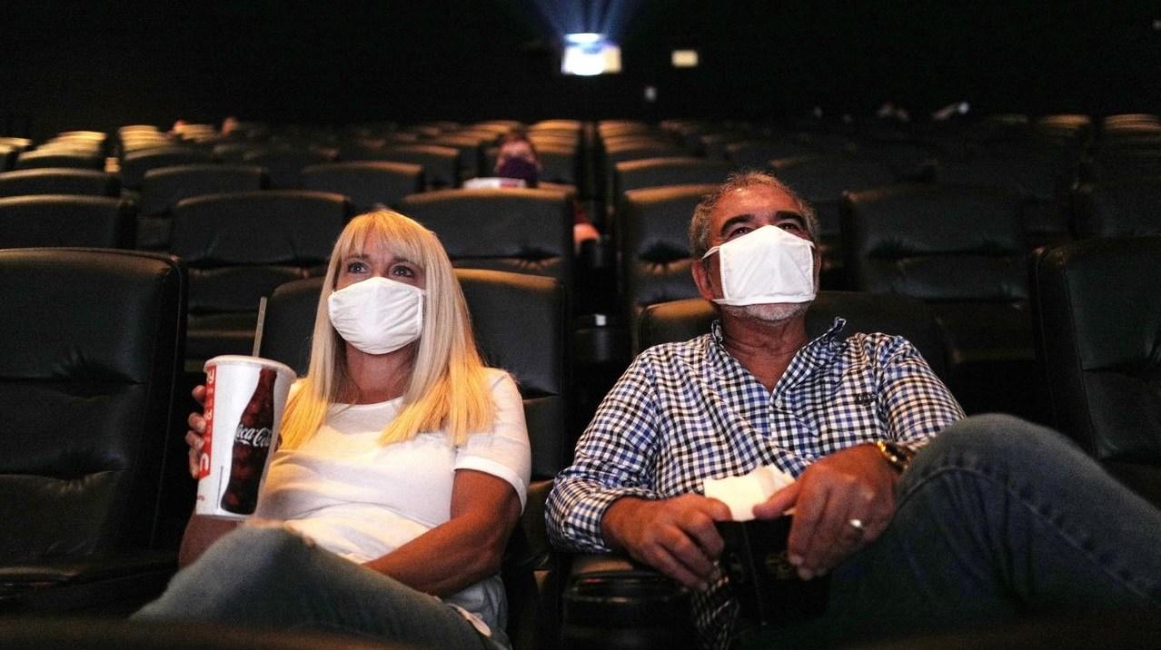 moviegoers wearing maskes at tenet screening 2020