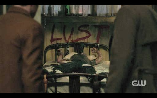 15.15 Dead cult body with LUST painted in blood over him