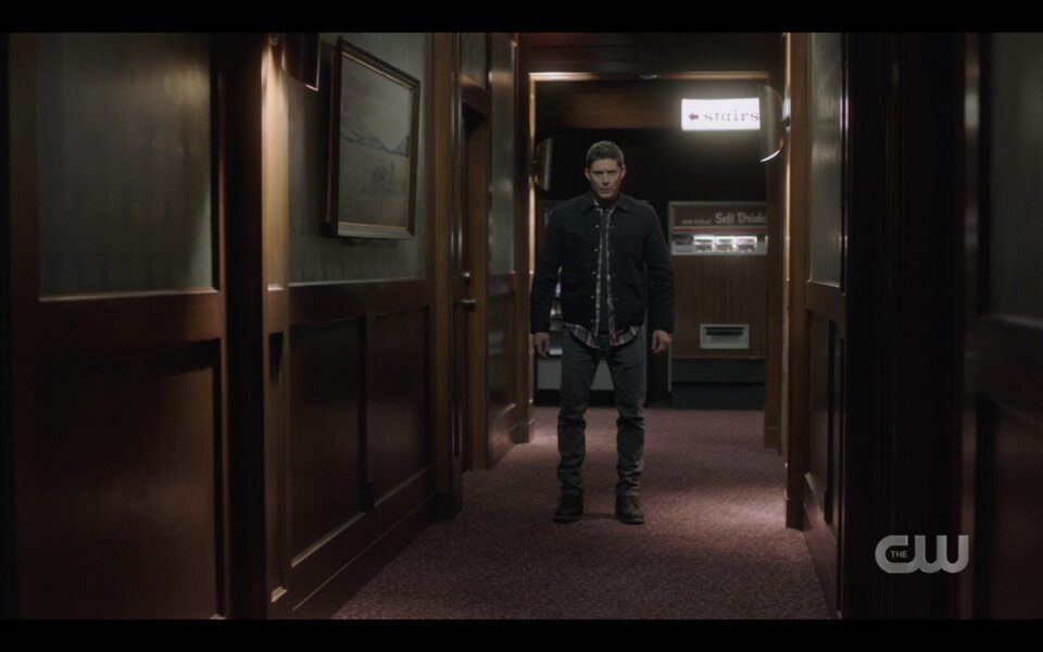 Dean Winchester walking down motel hallway in trance SPN