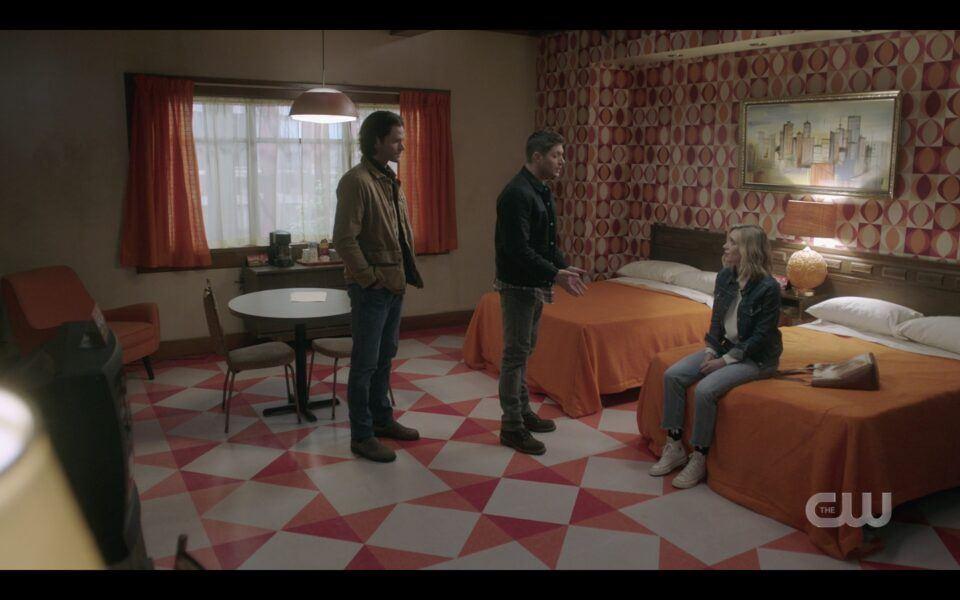 Sam Dean Winchester with Caitlin in orangle motel room SPN