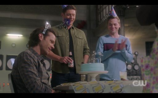 Dean Jack giving Sam Winchester a birthday cake with hat SPN