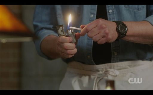 Dean Winchester lighting Jacks birthday candles for cake.