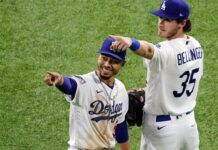 dodgers bellinger pointing at nfl ratings over baseball