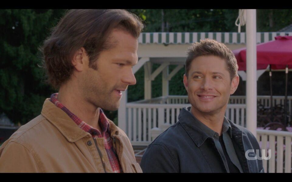 SPN Dean Winchester smiling wide with pies at Sam Winchester