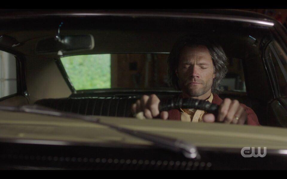 SPN Old Sam Winchester sitting in Impala in garage