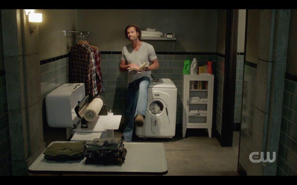 SPN Sam Winchester sitting on washer kicking it