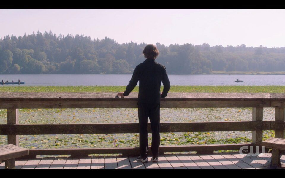 Sam Winchester running looking at lake SPN