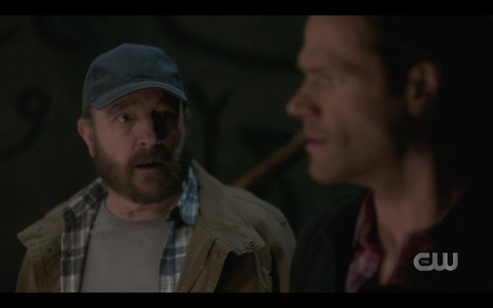 Sam Winchester standing next to Bobby in silo SPN 1518