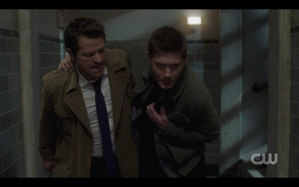 Supernatural Castiel helping heart attack Dean Winchester down hall after Billie