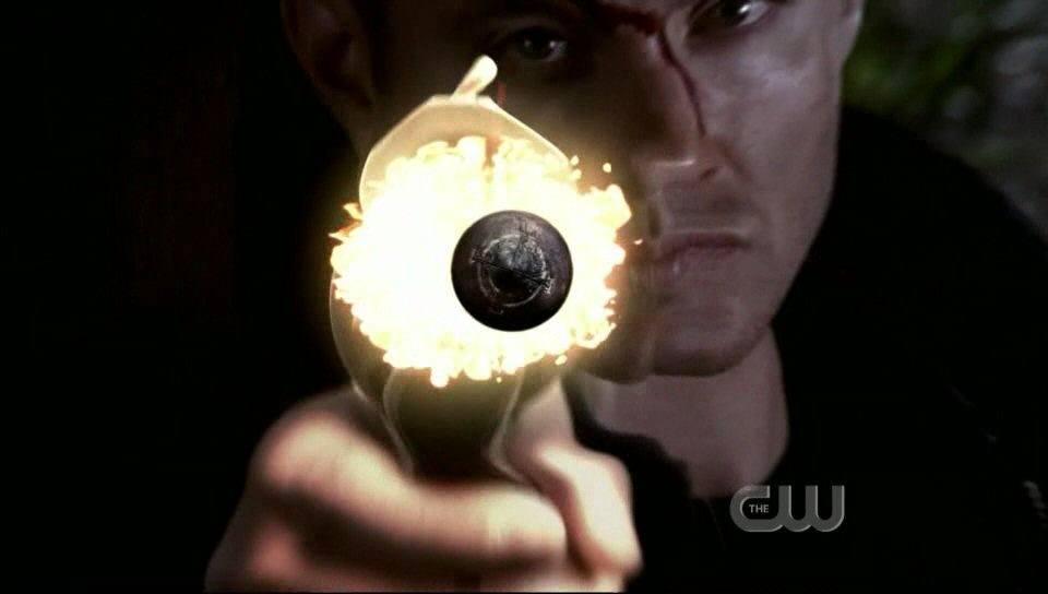 Supernatural all hell breaks loose Dean Wincheseter firing gun close up