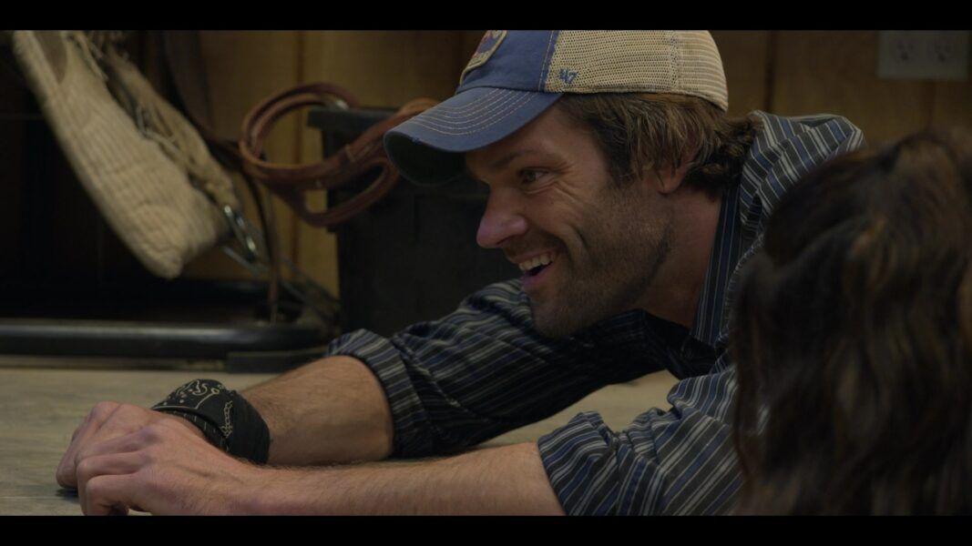 Walker Jared Padalecki as Duke on floor in baseball cap with Adriana