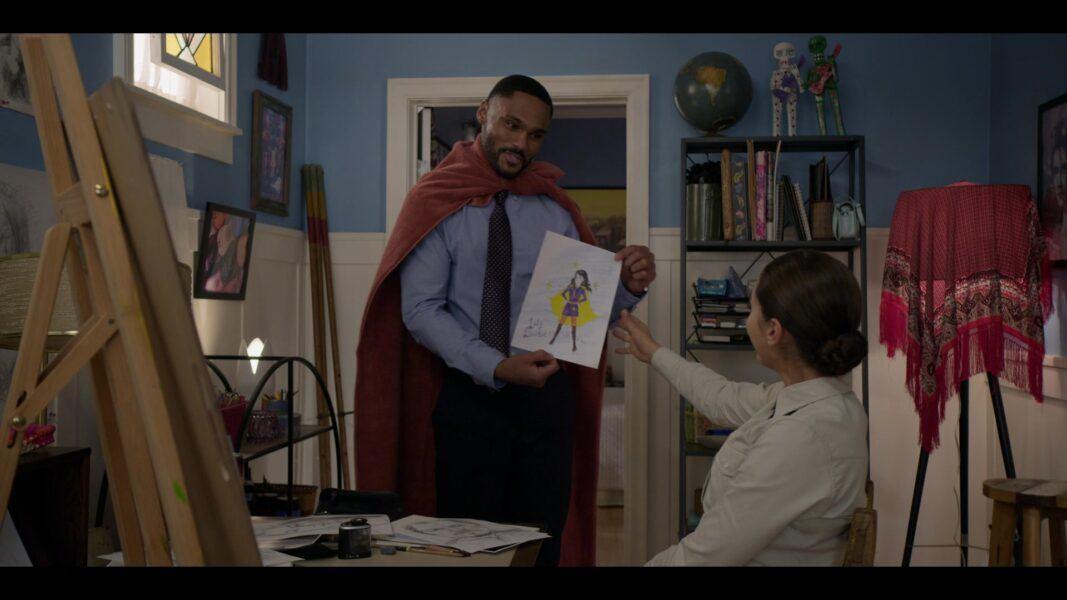 Walker Tred in cape giving Mickey art of superhero
