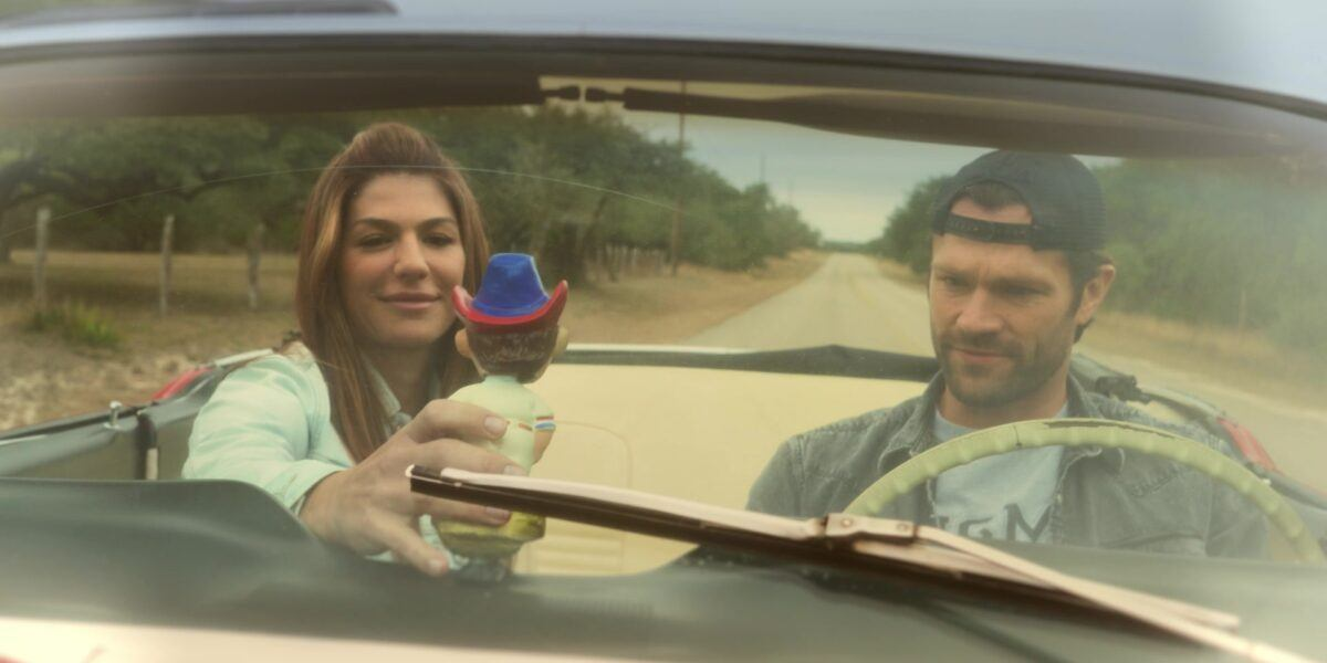 Walker flashback Emily puts bobblehead on Jared Padaleckis dashboard