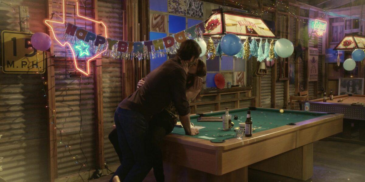 Walker and Micki playing pool at Side Step bar