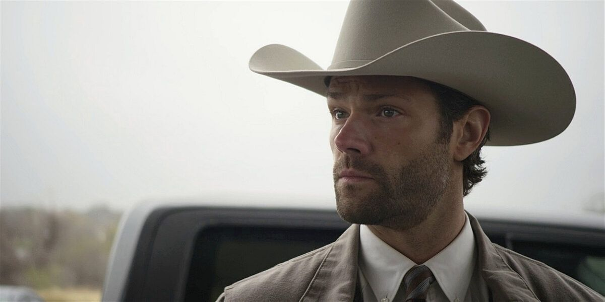 Jared Padalecki in Walker white cowboy hat with scruffy face.
