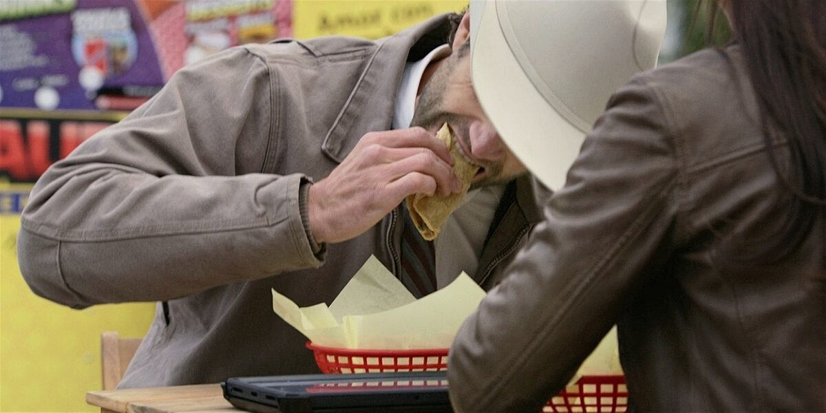 Jared Padalecki Walker chowing down hard on man meat sandwich.