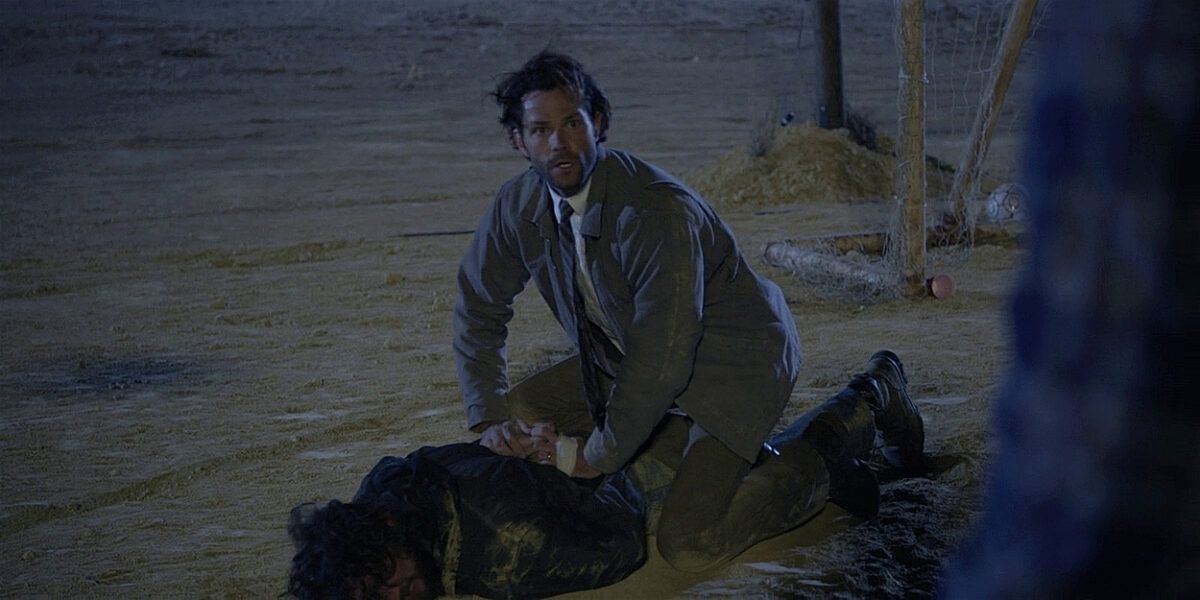 Jared Padalecki Walker holding guy down from Trevor with gun.