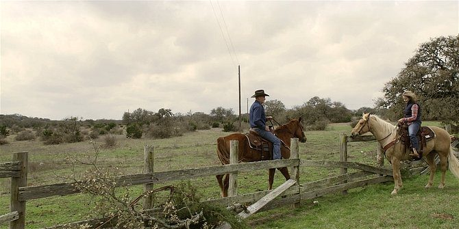 Walker Bonham and Abeline on horseback at the ranch.