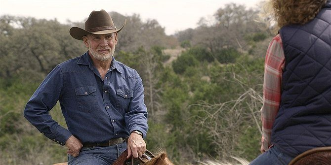 Walker Mitch Pileggi on horse talking to Abeline about Walker kids.