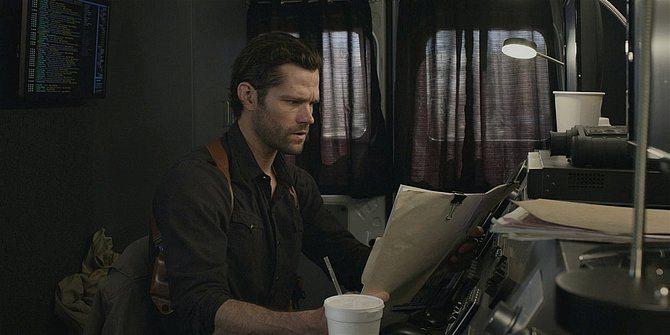 Walker Jared Padalecki reading police file on Geri at Northside Nation.