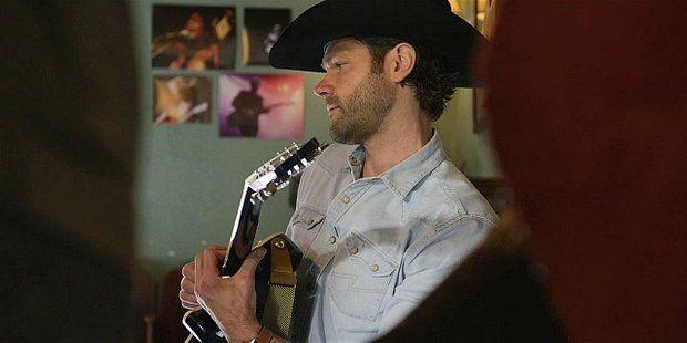 Jared Padalecki playing guitar on Walker 110 Encore.