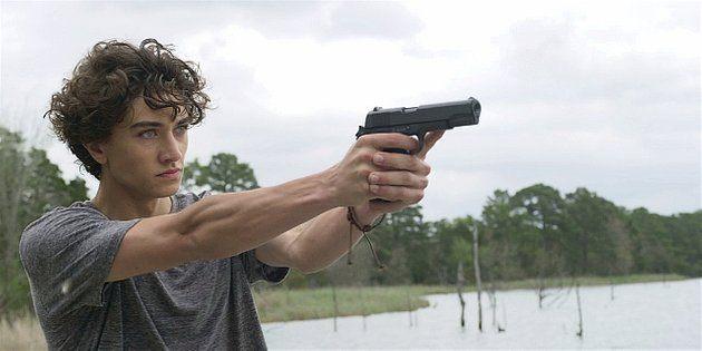 Walker Trevor pointing gun in boat 1.11.