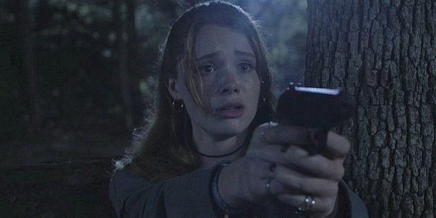 Walker STella pointing gun realizing she shot Jared Padalecki Cordell by accident.