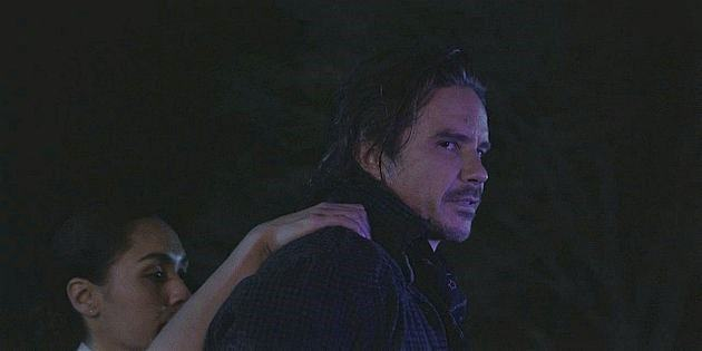 Clint looking back at Stella as he takes Trevor with him Walker 1.11.