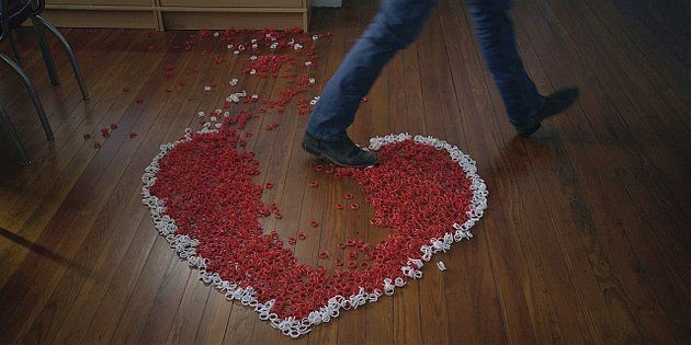 Walker Hoyt walking through plastic heart he made for Geri to marry him.