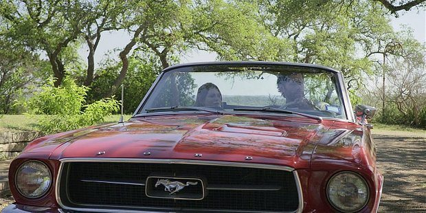 Walker Cordell and STella drive up in red Mustang to find Clint with gun.