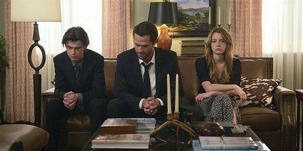 Walker 1.12 Cordell sitting between Stella Augie at Emily funeral.