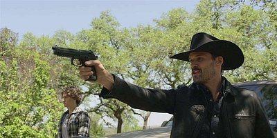 Walker Clint holding gun Cordell Jared Padalecki.