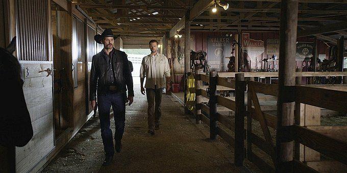 Walker Clint and Cordell walking in barn.