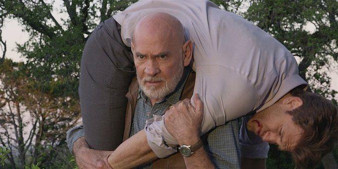 Walker Bonham carries an injured gay Liam over his shoulders 1.13.