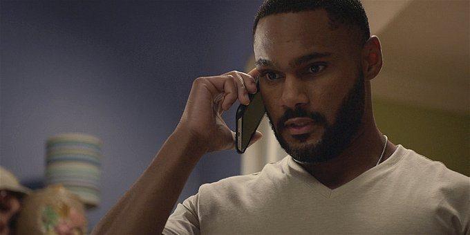 Walker black cop on phone.