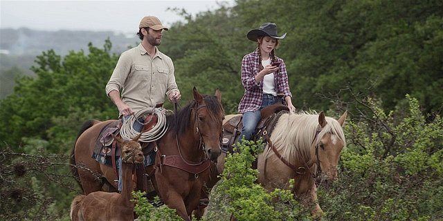 Walker Cordell and Stella riding horsesback together.