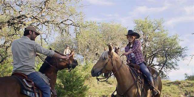 Walker Cordell keeping Stella safe on their horses.