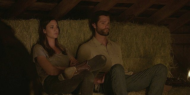 Walker Cordell sitting with Geri on bales of hay 1.14.
