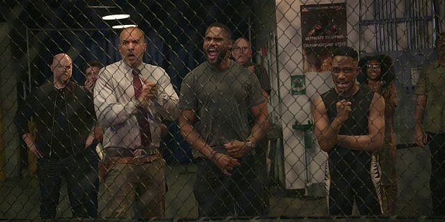 Walker Captain James and Trey rooting on Micki fighting in cage.