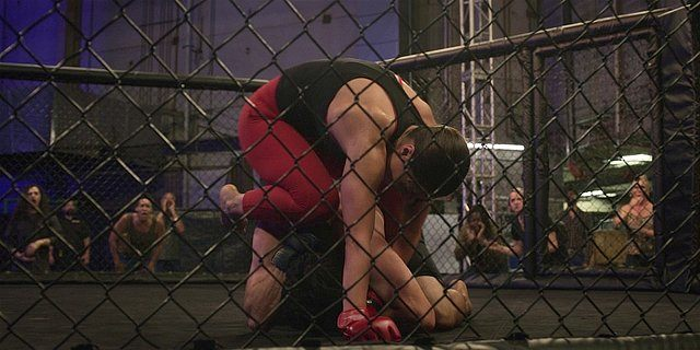 Walker Micki in the ring fighting with another person.