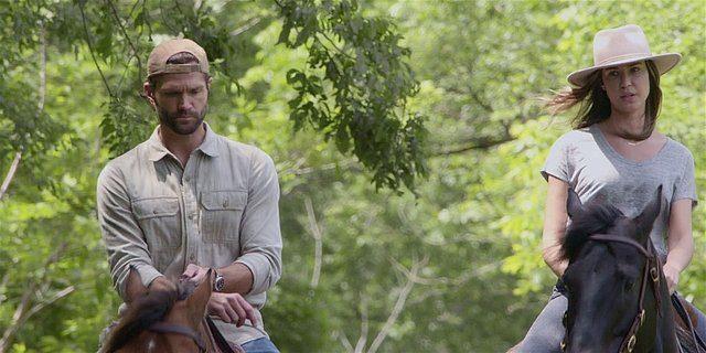 Walker Cordell riding horse with Geri baseball cap turned backward.