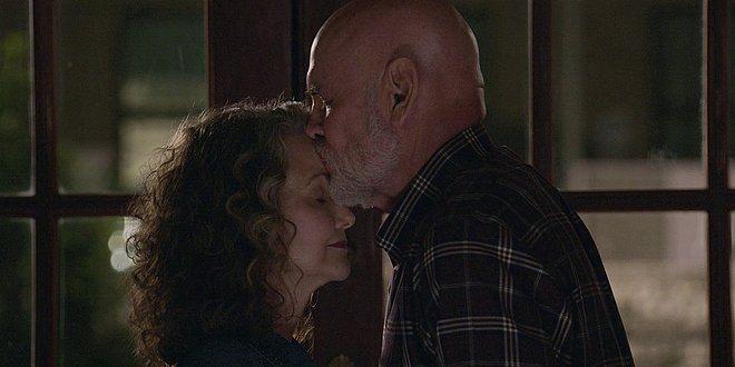 Walker Bonham giving Abiline a deep kiss on forehead.